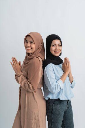 muslim hijab woman greeting over white Stock Photo