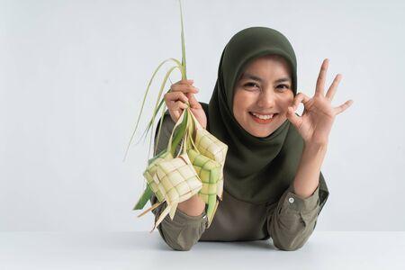 muslim woman showing ketupat