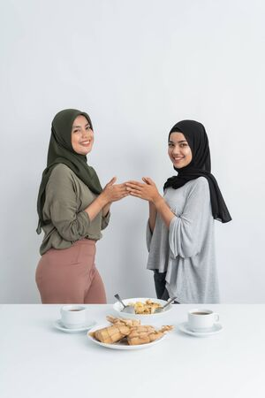 woman muslim apologizing together