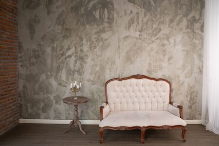 Vintage cream coloured luxury armchair isolated with clipping path 스톡 콘텐츠