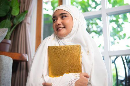 woman wear hijab read quran