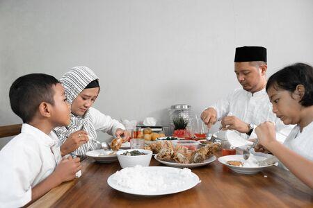 muslim asian family having sahoor or sahur