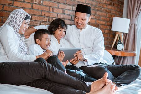muslim family using tablet togethe