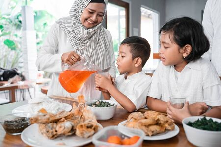 muslim iftar dinner. family breaking the fast