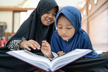 kid muslim reading quran Stock Photo