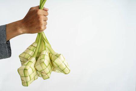 hand hold ketupat