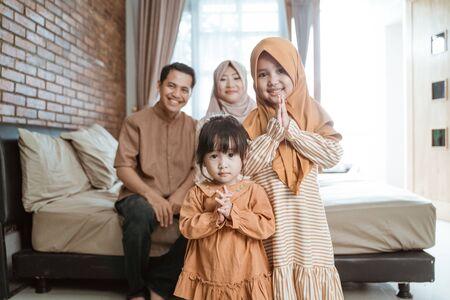 happy smile kid muslim with parent on ramadan