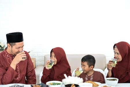 Malay break fasting together family