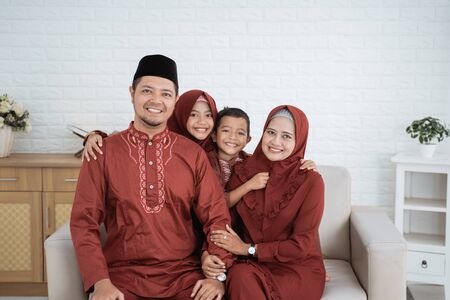 Eid Mubarak concept,asian family wearing Malay traditional clothes