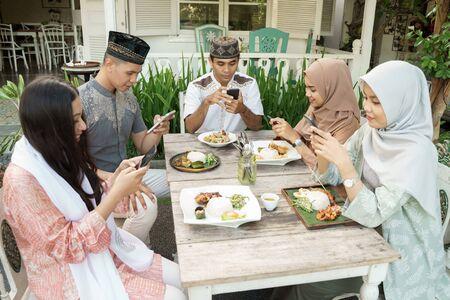 muslim people busy on their phone