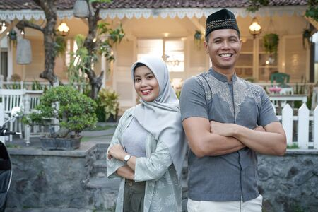 muslim asian couple crossed their arm and smiling