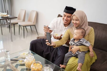 muslim family taking selfie together
