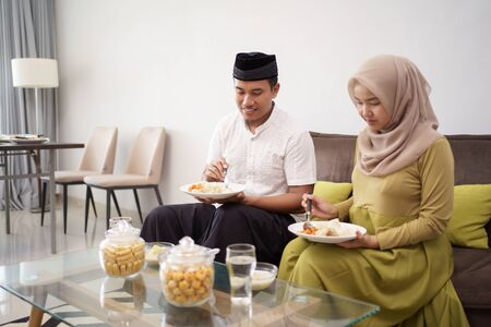 Asian couple muslim breaking the fast