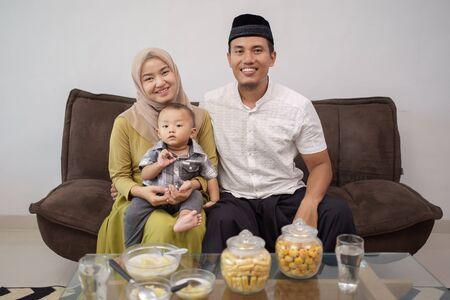 family having snack on hari raya or eid mubarak Stock Photo