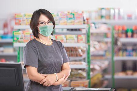 female shopkeeper with masks