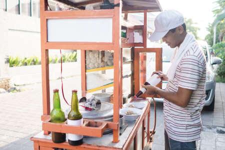bakso seller preparing the dish for customer Stock fotó