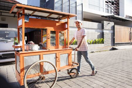 man selling bakso in the carts