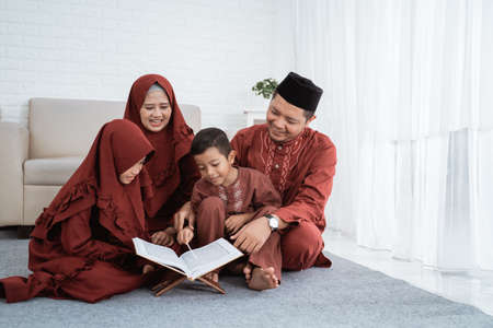 Asian family learn Quran bible together when spare time