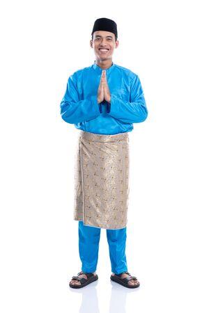 portrait of muslim with baju koko hari raya