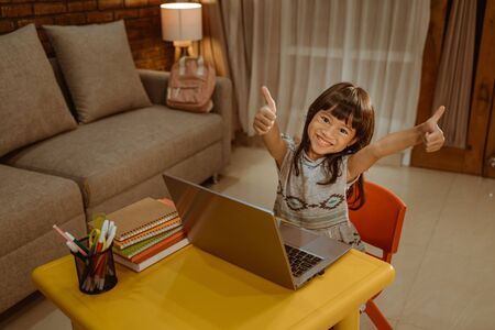 showing thumb up while doing homework