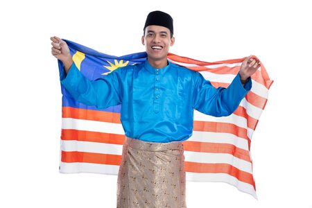 excited malaysian male muslim with flag