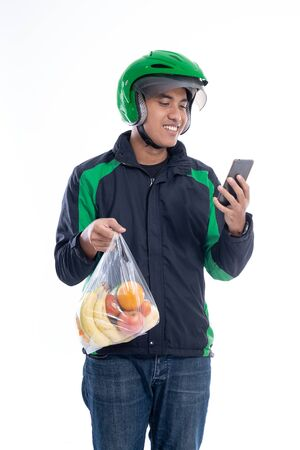 courier wearing helmet and jacket uniform holding food isolated