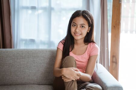 young teenage girl smiling to camera