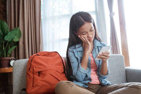 teenage asian girl feel depress while using phone