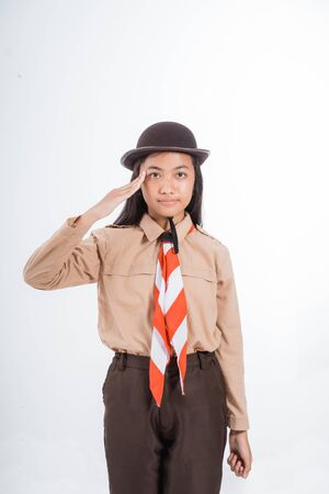 girl scout giving salute gesture
