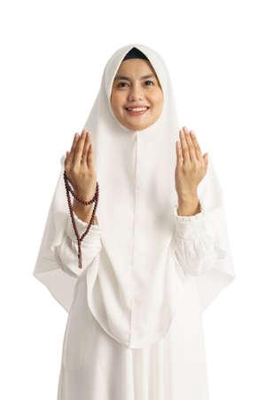 Muslim young woman praying open her arm