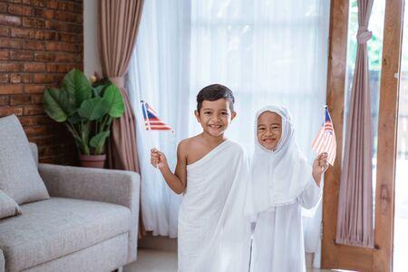 kid wearing muslim ihram clothes and dress