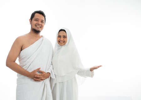 umrah couple presenting copyspace