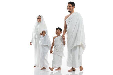 muslim hajj family and children walking and hold hand
