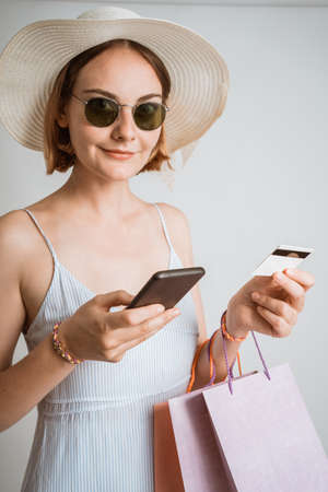 beautiful woman using mobile phone to shop online