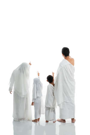 asian muslim family hajj shot from behind with copyspace