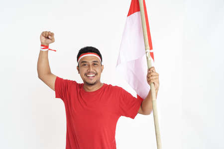 excited male holding indonesian flag Stock Photo