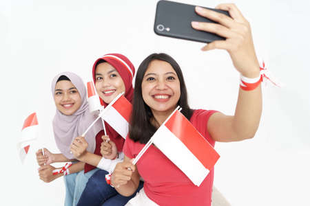woman taking selfie while celebrating indonesian independence day