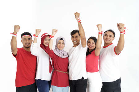excited friend raised arm on indonesian independence day Banque d'images