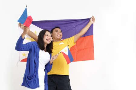 filipino couple holding flag celebrating independence day