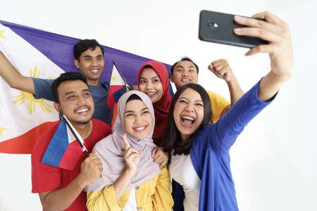 filipino supporter taking selfie self portrait together