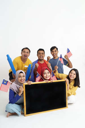 supporter holding malaysia flag and blank blackboard Stock Photo