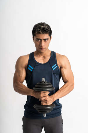 young man wearing gym clothes lift the dumbbell with both hands Stock Photo