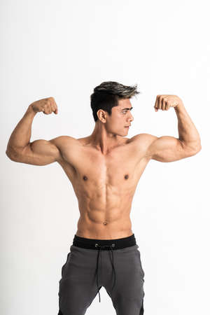 young man showing muscular biceps stand facing forward Stock Photo
