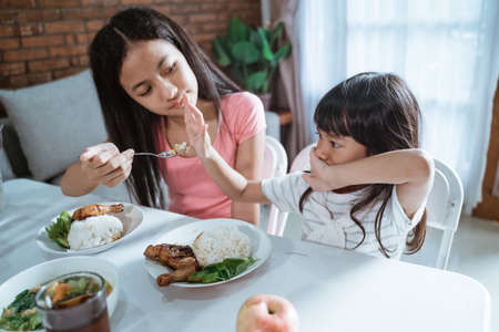 little girl refuses to eat and her older sister is annoyed Stock fotó