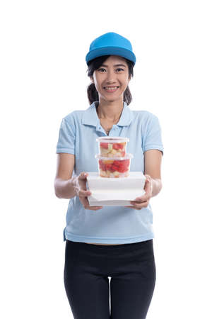 female delivery courier bring groceries