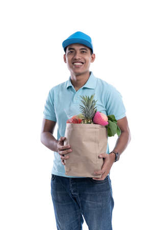 online courier carrying groceries 免版税图像