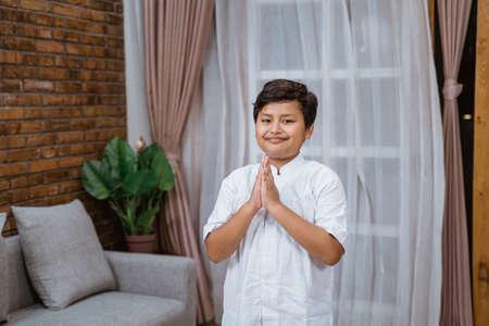 Asian Muslim boy say Salaam