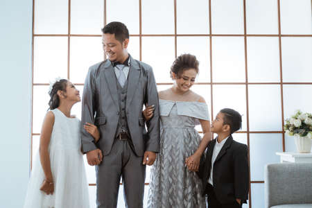 Portrait of a happy family with modern clothes. Family photo concept