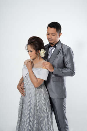 Portrait men and women wearing wedding dresses and suits. Couple photo concept Stock Photo
