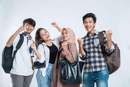 excited grup of college asian friends Standard-Bild